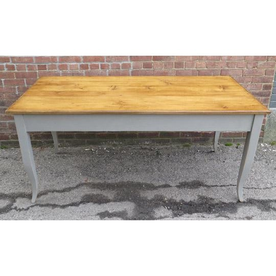 Antique French (c. 1900) pine table with hand rubbed waxed top and newly painted grey base with unique flared legs.