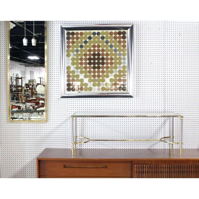 Very nice 3-D modern wall art or sculpture frames in a nice quality aluminum frame.