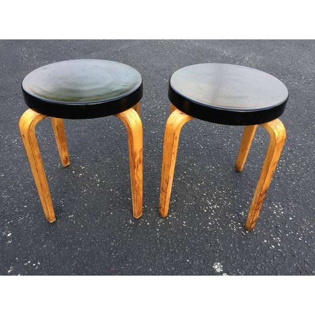 SOLD-Pair of authentic Thonet stacking stool tables. Classic black hard plastic top with bentwood legs. Signed Thonet...