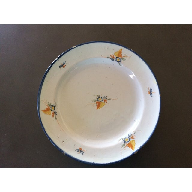 Early antique hand painted platter from Provence with blue and french mustard gold flower motif. Charming piece of history...
