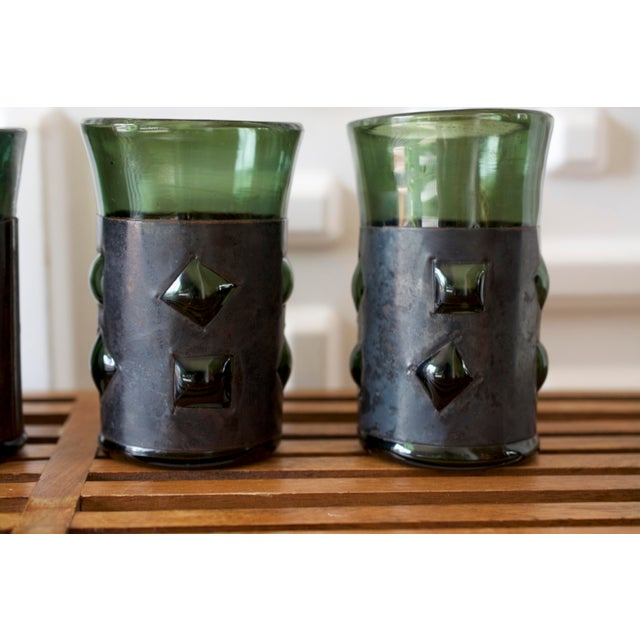 This listing is for a mid-century set of vintage, brutalist glass tumblers by Felipe Derflinger. They feature caged, green...