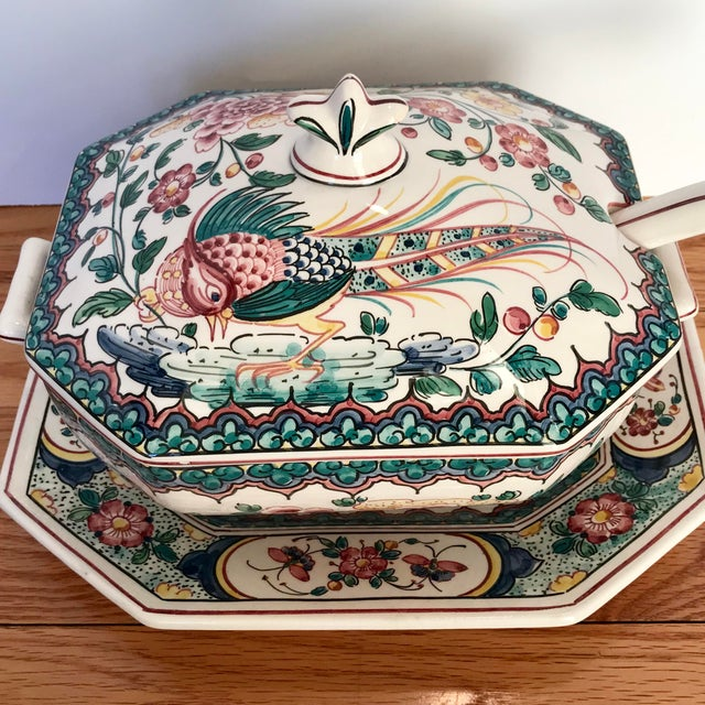 This 3-piece hand painted ceramic tureen set includes a lidded tureen, ladle, and serving platter/under plate. Gorgeous...