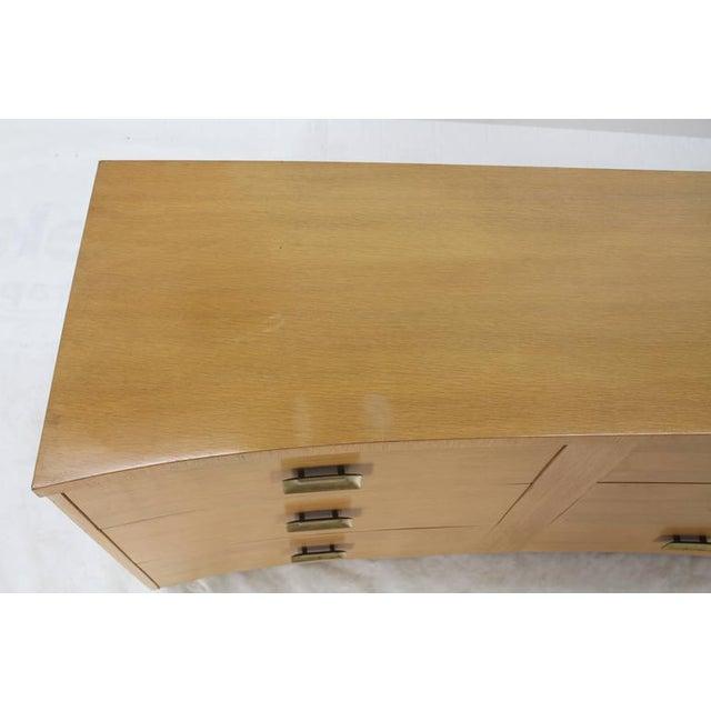 Mid-Century Modern long coerced oak dresser with brass pulls.