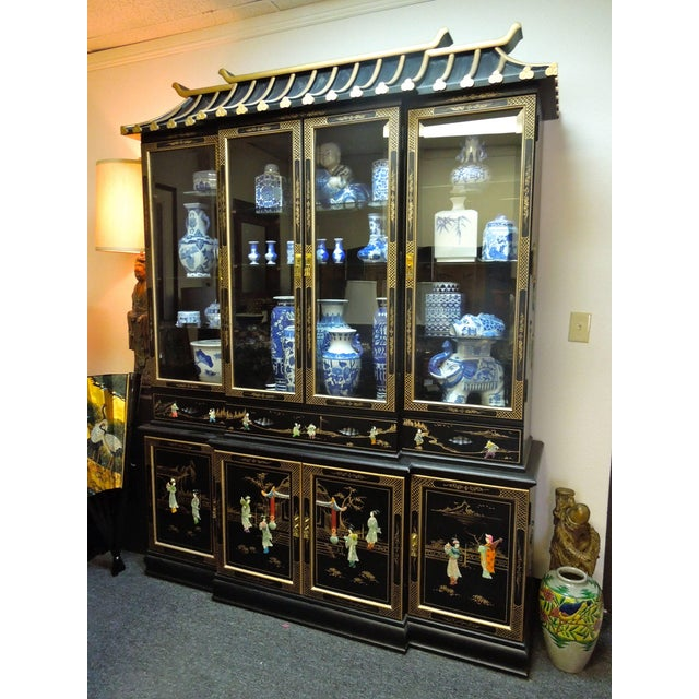 A very rare and beautiful buffet cabinet in the pagoda top chinoiserie design. The piece comes apart in three pieces....