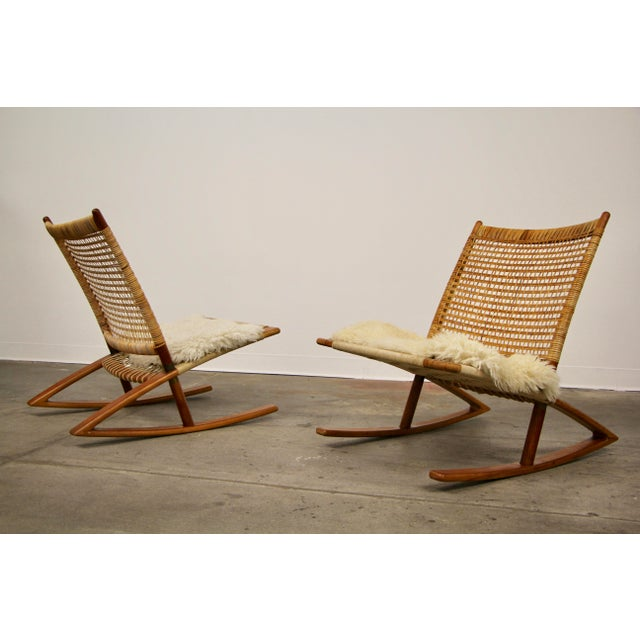 A pair of Norwegian rocking chairs designed by Fredrik Kayser for Vatne Mobler, 1950s. Teak frame, with woven cane back,...