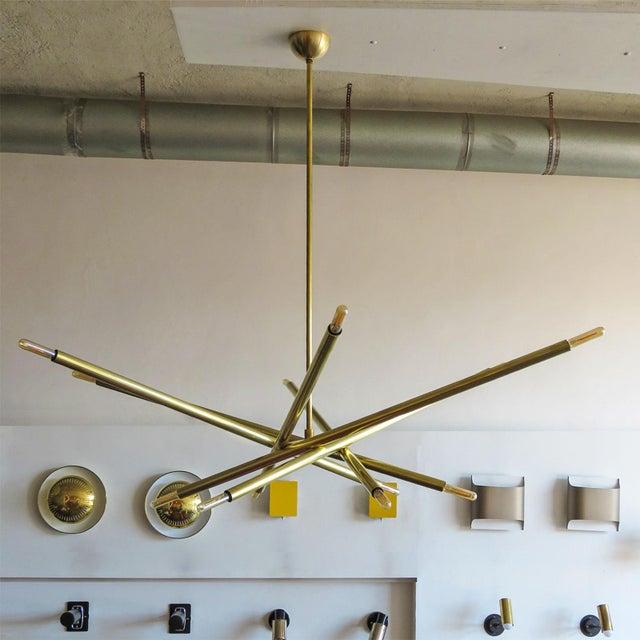 Stunning extra large six-arm, twelve-light chandelier by Gallery L7 in raw brass, upper diameter: 48″, lower diameter 24″,...