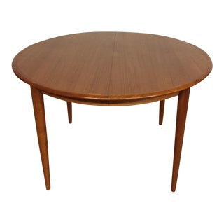 Skovmand and Andersen for Moreddi Round Teak Dining Table With Three Leaves - Made in Denmark For Sale