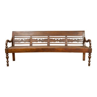 Dutch Colonial Late 19th Century Bench with Carved Back and Scrolling Arms For Sale