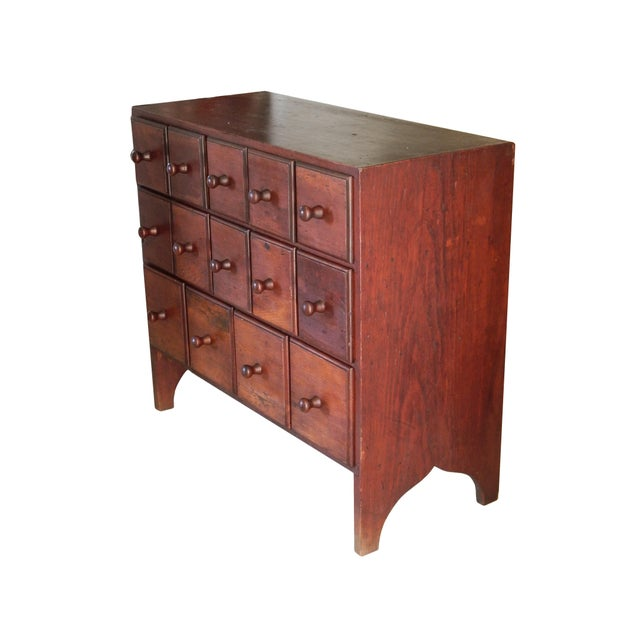 Small 14 draw cubby dresser -different size drawers .