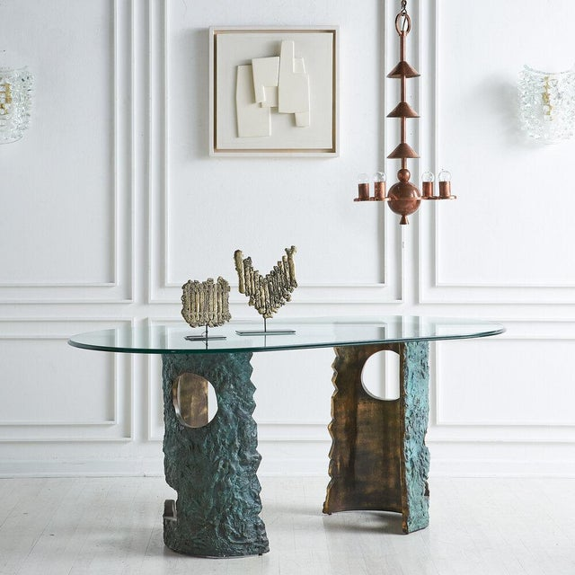 A remarkable dining table by Valenti Madrid from the 1980's. Two sculptural metal bases feature bronzed finishes with an...