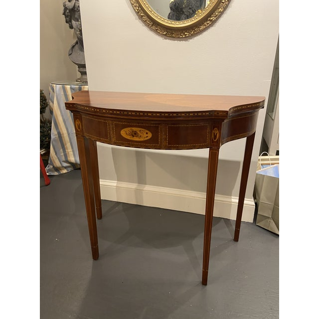 This is a beautiful antique card table. It is a Hepplewhite style with inlay. It has a satin band and ebony inlay. The...
