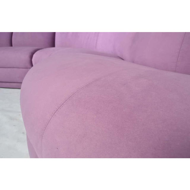 A stunning 3 piece serpentine sectional sofa designed by Milo Baughman having plum microsuede upholstery that has been...