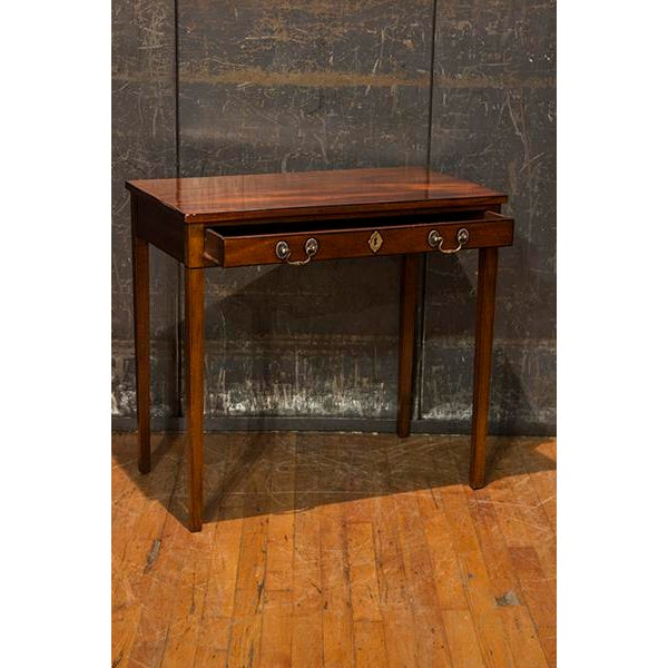 Beautiful English mahogany single drawer side table with double pulls, key hole escutcheon and tapered legs. Made in the...