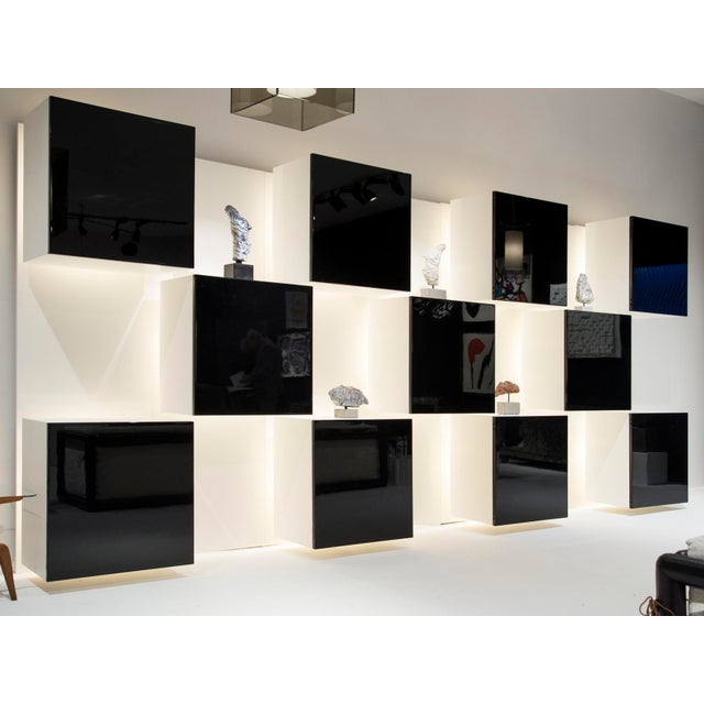 Acerbis International Rare library / bookcase Composed of 7 panels with 1 and 2 bookcases per panel The panels can be...