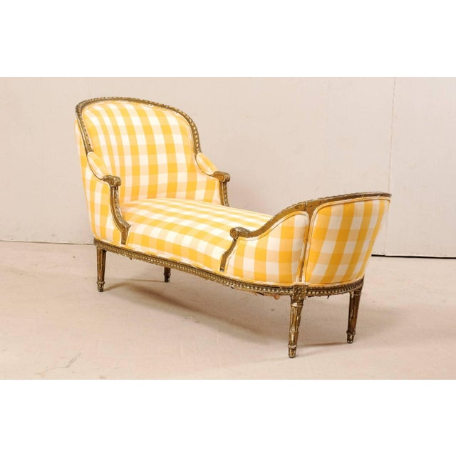 A French Louis XVI style chaise lounge from the turn of the 19th and 20th centuries. This antique Duchesse en Bateau...