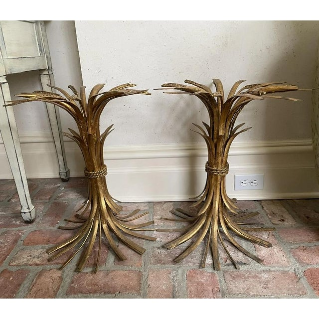 A beautiful pair of Italian, gilded iron side tables in sheaf of wheat form. Classic and elegant.