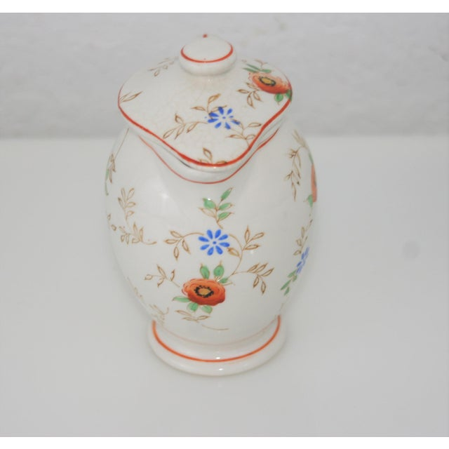 Vintage Ceramic Floral Design Lidded Syrup Pitcher Orange, Yellow, & Blue Floral Pattern Lovely dainty style pitcher with...