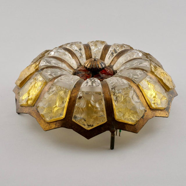 Round flush mount fixture found in Italy features a bronze ribbed frame with petal shaped glass inserts, circa 1950s....