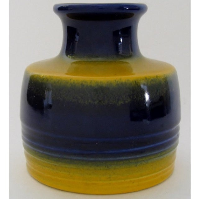 1960s German ceramic vase by Terraform, finished in primary blue and yellow glaze. Original label on visible part of vase.