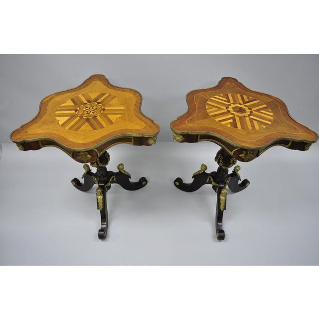 Item: A Pair Louis XV French Style Reproduction Marquetry Inlaid Side Tables with Bronze Figures Details: Bronze ormolu...