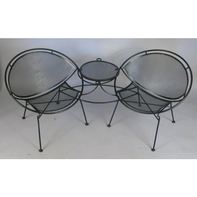 A fantstic wrought iron 'tête-à-tête' settee lounge from Salterini's Radar collection, designed by Maurizio Tempestini,...