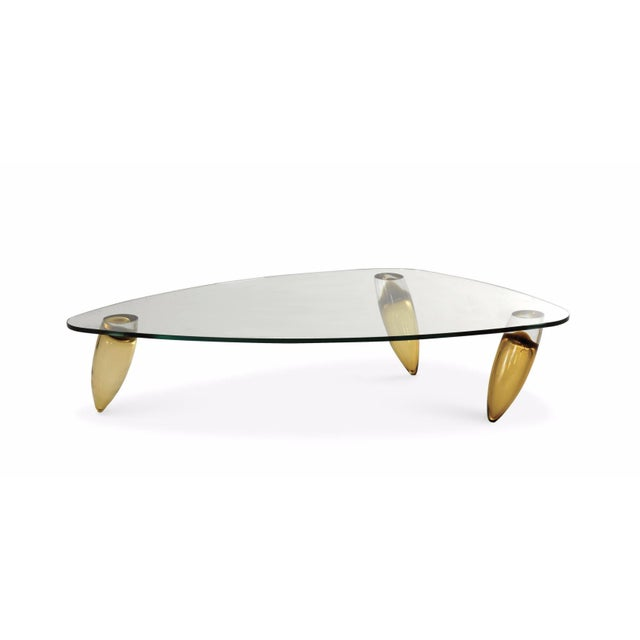 A Roche Bobois Murano coffee table with Murano legs and a glass top. Originally purchased for $7410. This piece was...
