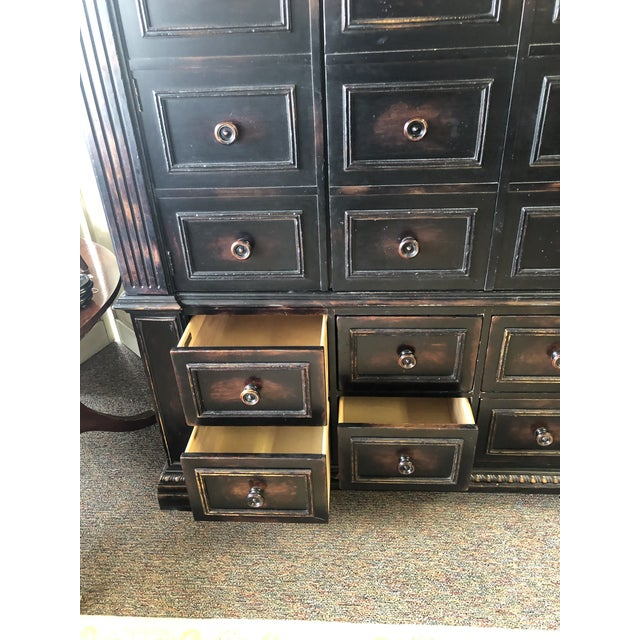 Massive and heavy piece of furniture. (2 pieces) Will certainly cover all of your storage needs or you can use it as a TV...