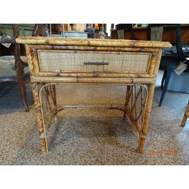Really sweet pair of French bamboo side tables with one drawer. Wicker top. In perfect condition.