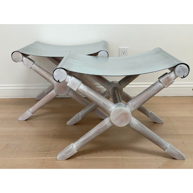 A pair of mid-century modern cerused finish and galvanized iron sheet X-bench. Wooden X-leg is in the style of Jean Michel...