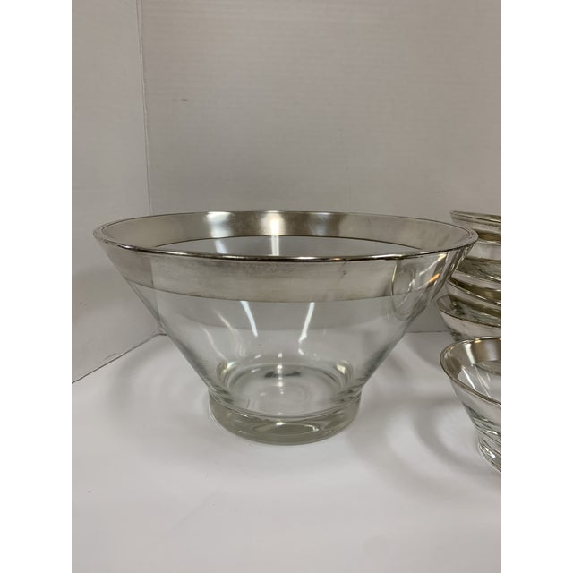 Rare! Large glass salad bowl with six individual salad bowls. All clear glass with silver rims. Perfect for your table....