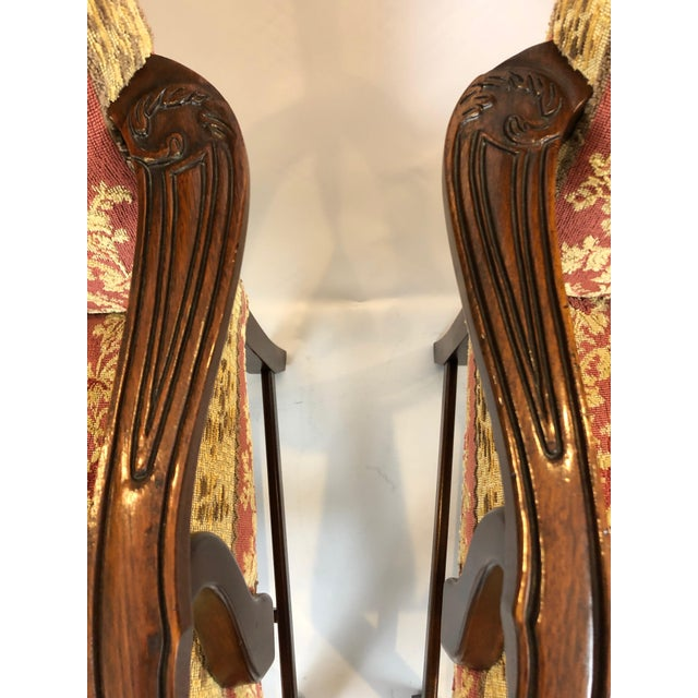 A regal pair of carved mahogany armchairs having beautiful rope edging on the straight traditional style legs, scalloped...