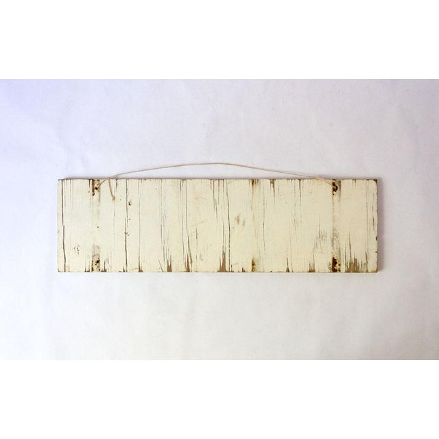 Vintage hand painted wooden exit sign. Navy blue lettering and vintage white background. Can be hung from twine or...