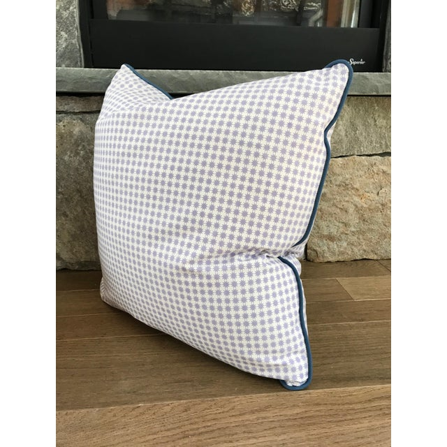 """Custom down-filled 20"""" pillows with contrast blue welt and hidden zipper in Schumacher's """"Stella"""" in Lilac on a white..."""