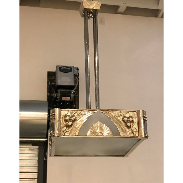 French Art Deco chandelier having frosted glass panels. Held by polished nickel frame with incredible deco details...