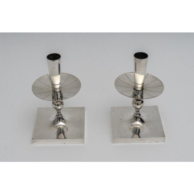 This stylish set of silver plated candlesticks were designed by the iconic designer Tommi Parzinger and date to the 1960s....