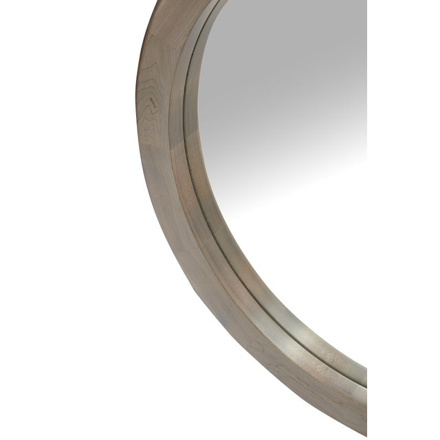 A multi-tone circular floor & wall mirror 14 blocks of timber joined to form one harmonious ring.