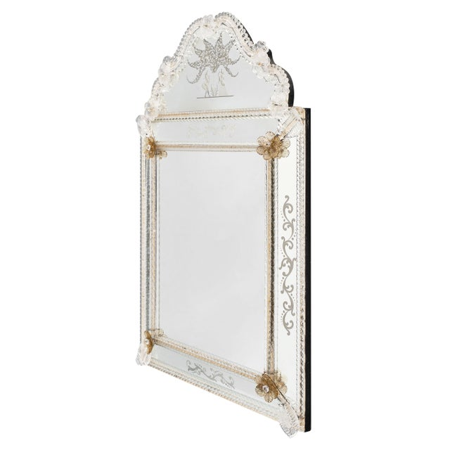 Antique Venetian mirror with pieces of compartmental mirrors chiseled with floral decor. A romantic scene can be found on...