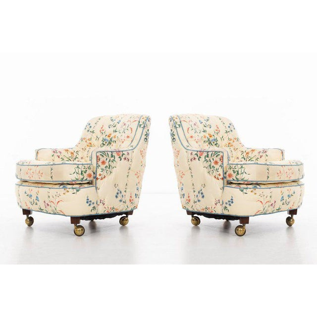 Edward Wormley (1907 - 1995) Pair of curved-back club chairs in the original upholstery, raised on tapered walnut legs...
