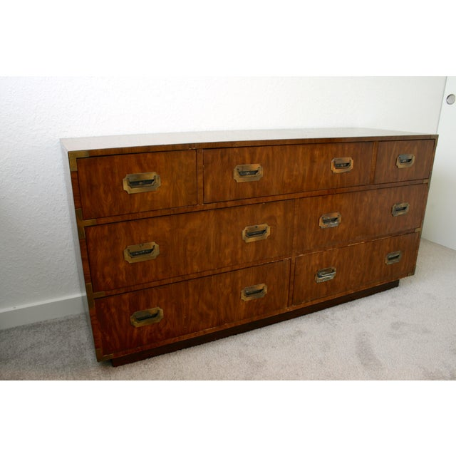 Campaign style lowboy dresser by Dixie Furniture Company. Seven dovetail drawers, original brass hardware and lovely wood...