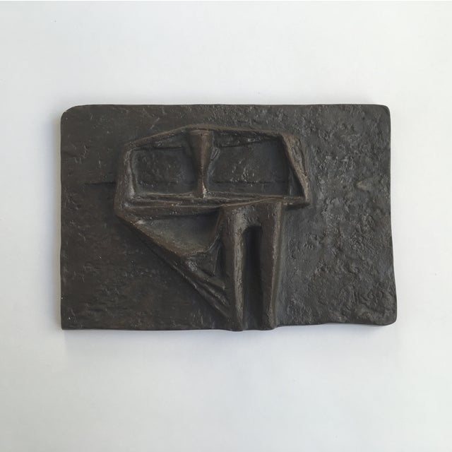 Mid-century modern abstract Brutalist metal wall sculpture. Made out of solid metal. Signed. Circa 1960. Dimensions: 7.5ʺW...