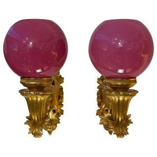 Gilt Bronze Dore Sconces With Pink Glass Globes - a Pair For Sale