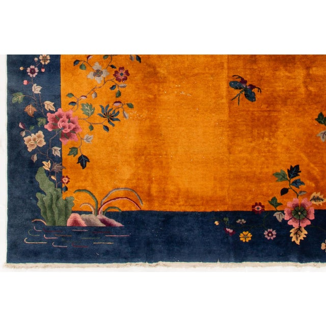A hand-knotted antique Chinese rug with a floral art deco design. This piece has great detailing and colors. It would be...