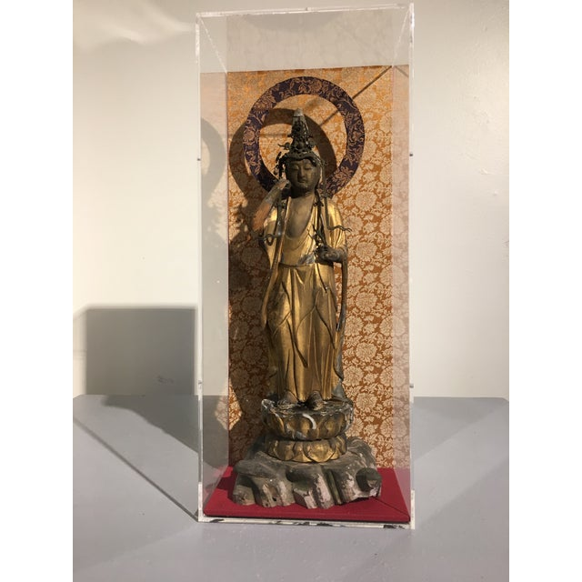 A wonderful Japanese carved, lacquered and gilt wood figure of the Bodhisattva of Compassion, Kannon, also known as...