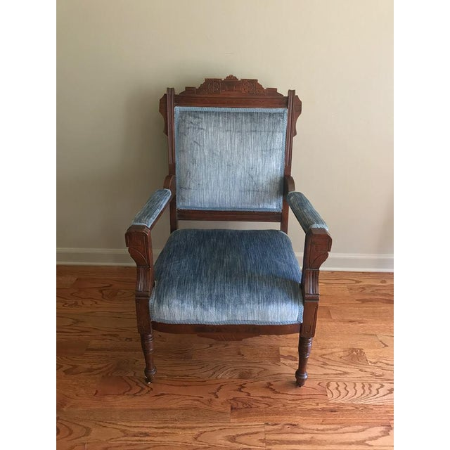 Turn-of-the-century blue velvet chair with dark walnut finish. Some light age appropriate wear.