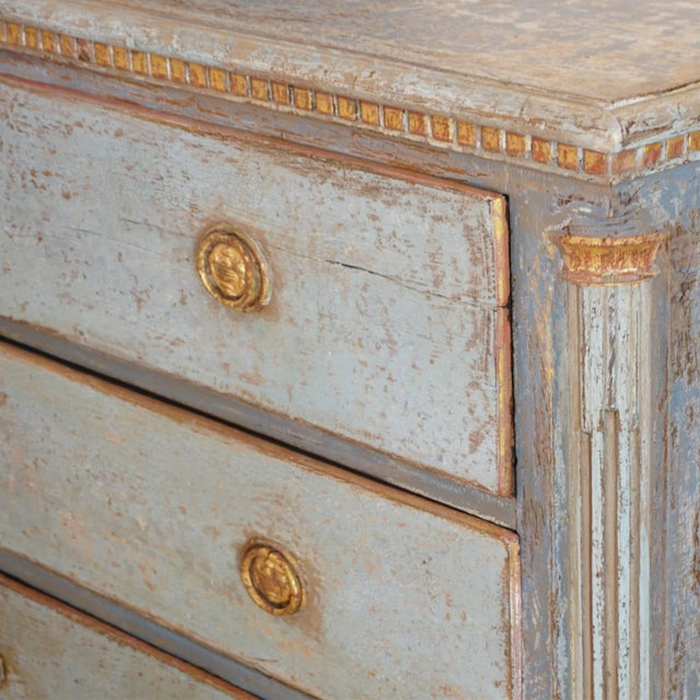 Early 19th Century antique Neoclassical Swedish commode of pinewood with four drawers in a refreshed blue-grey finish....