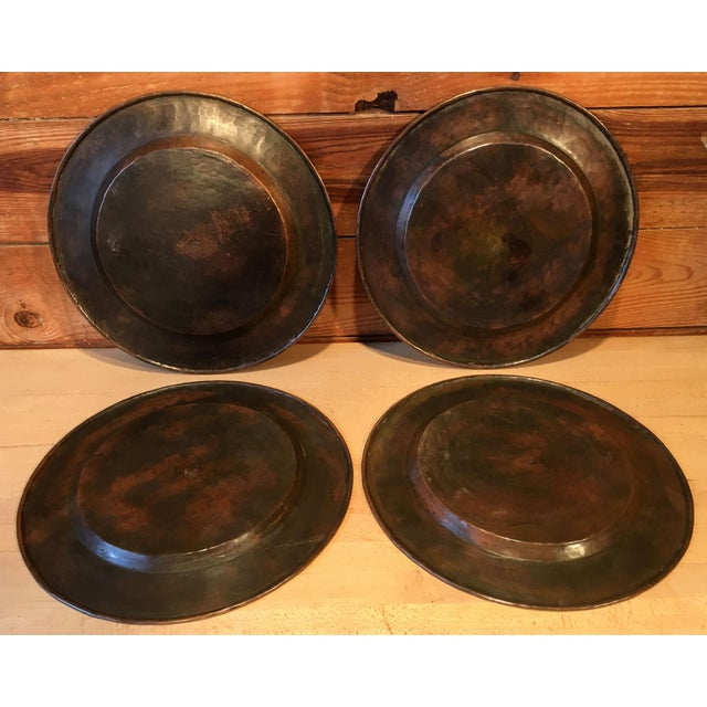 Fabulous set of 4 antique c.1900's arts & crafts period hand hammered copper plates by the world renowned Roycroft...