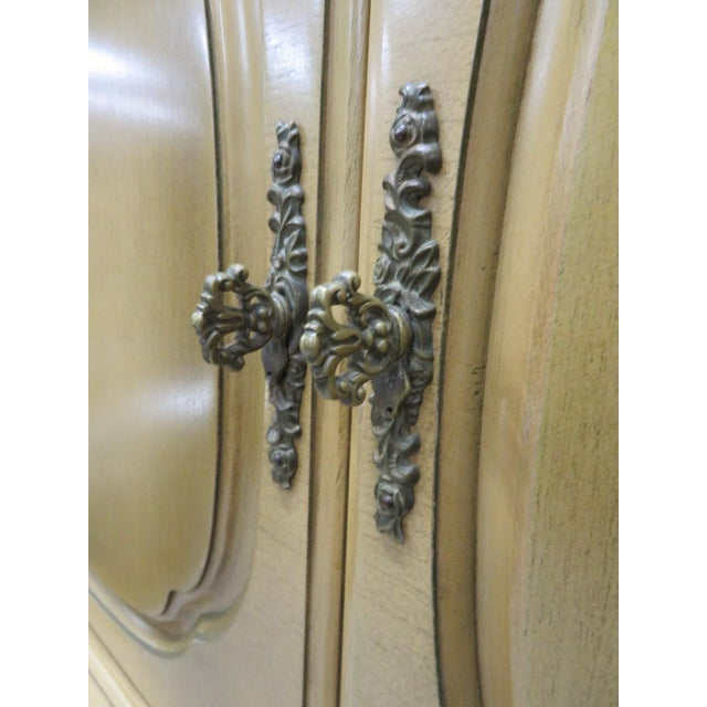 Large French style Bombay form chest of drawers , fancy cast brass hardware . Doors on top open to 3 drawers, 4 Drawers on...