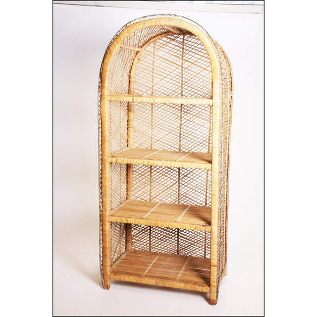 Vintage Boho Chic Bookcase with rounded dome top. Solid wicker with rattan accent. Four shelves at different heights....