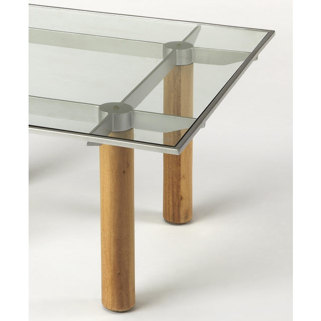 "This square cocktail table blends materials for a unique ""techy"" modern aesthetic. Framed within a satin aluminum finished..."
