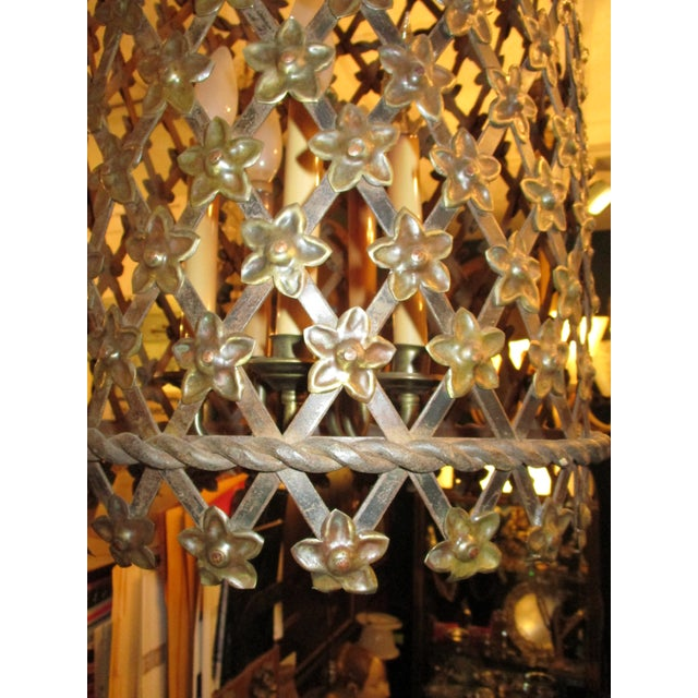 Beautiful bronze tone tole lantern. Wovern diagonals with floral rosette at every point. Five Edison lights on central...